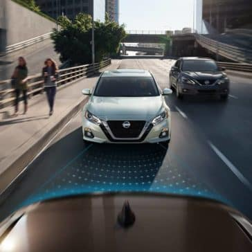 2019 Nissan Altima models shown approaching from rear on street