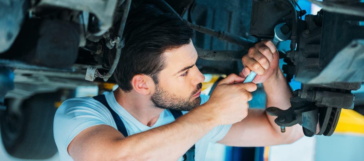auto mechanic performing tune up
