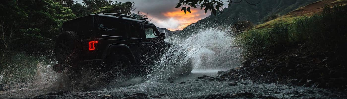 Jeep Wrangler off-roading through water