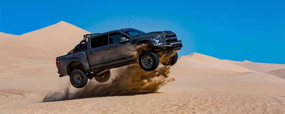 2018 Ford Tuscany Shelby Baja Raptor getting air on sand dunes