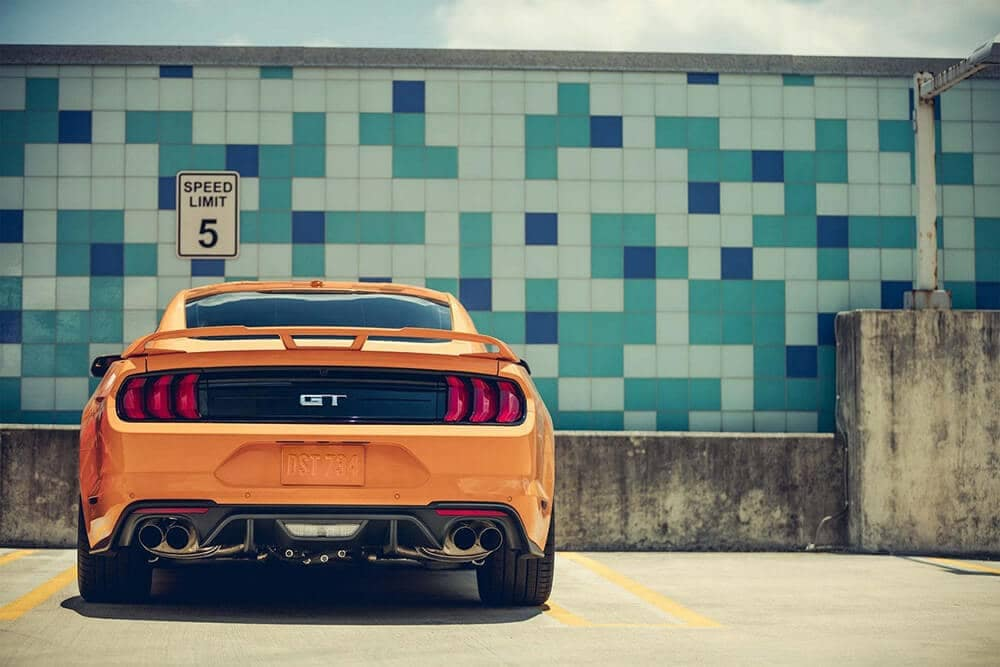 rear view of orange mustang
