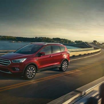 Picture of 2018 Ford Escape red, on a bridge, driving fast