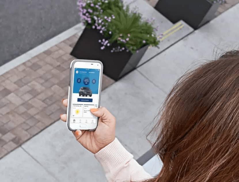 woman using fordpass on phone