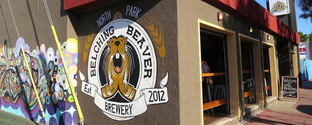 Outside wall of the Belching Beaver restaurant with artistic graffiti
