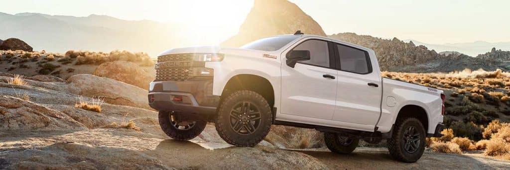 2019 Chevrolet Silverado 1500 Trail Boss Summit White off road on rocks
