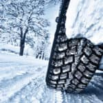 car tires on snow covered road