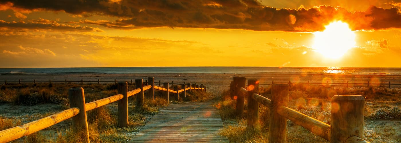 boardwalk beach at sunset