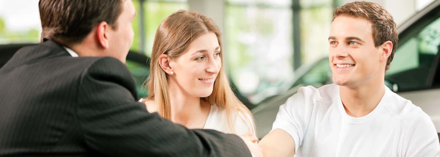 Couple Closing Deal at Dealership