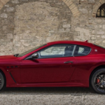 Red GranTurismo Against Stone Wall