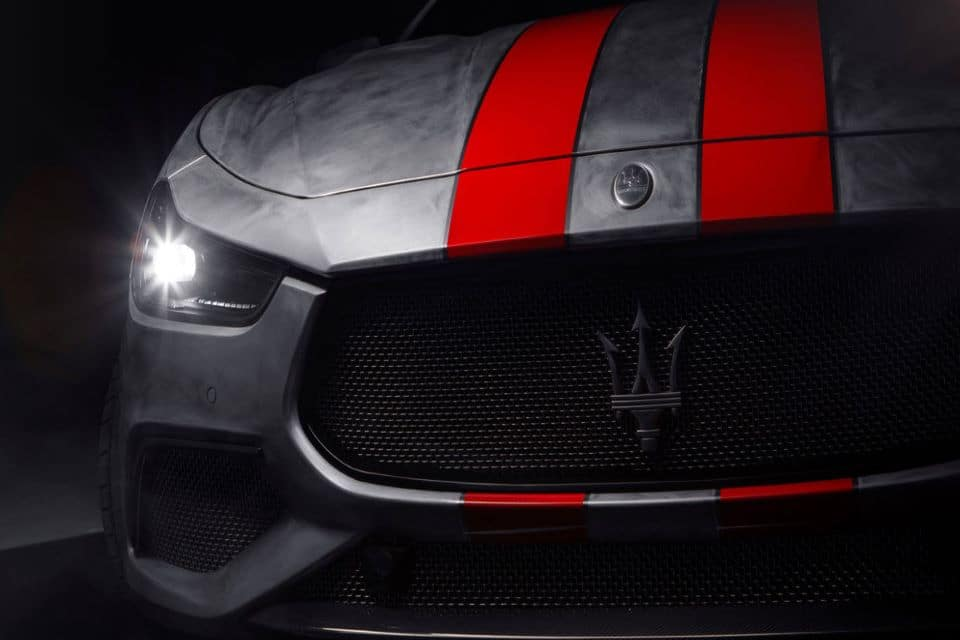 The 2020 Maserati Fuoriserie Corse. It has gray paint with two red racing stripes on the hood.