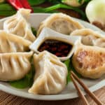 dumplings with pork meat and vegetables on a plate