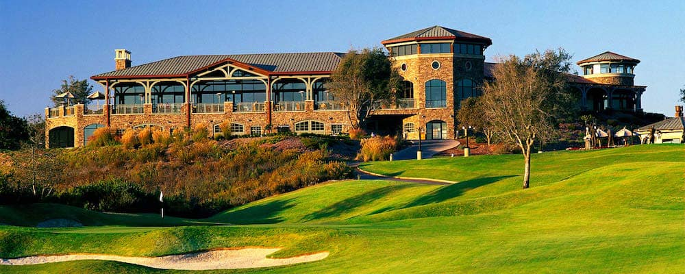 Elegant golf course in front a large brick building