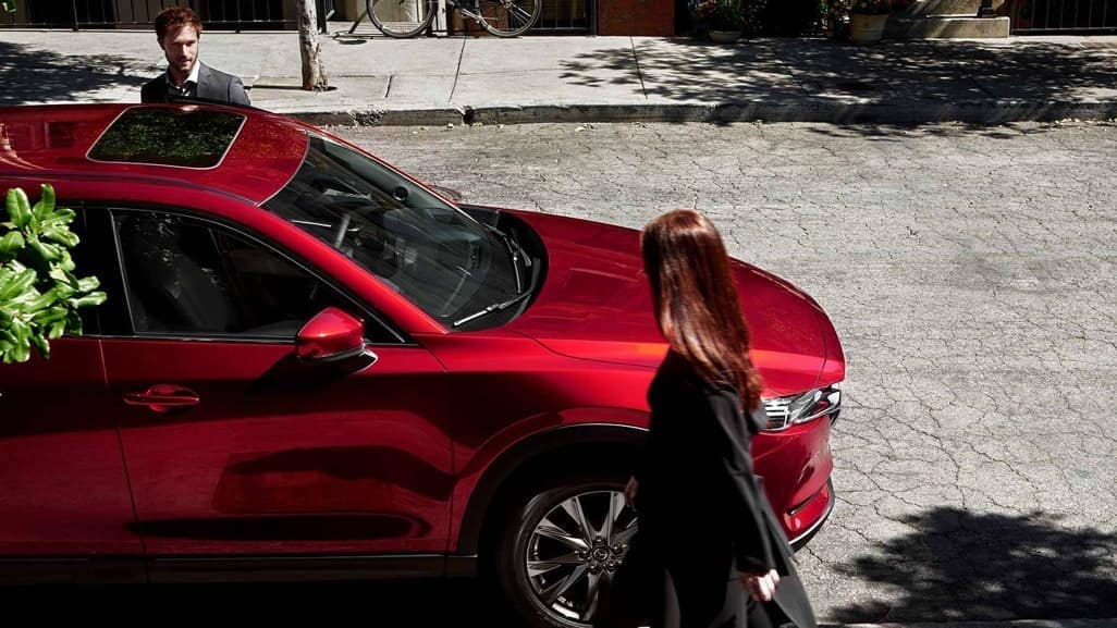 Woman walking past 2019 Mazda CX-5