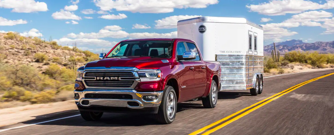 All-New 2019 Red RAM 1500 Towing A Trailer