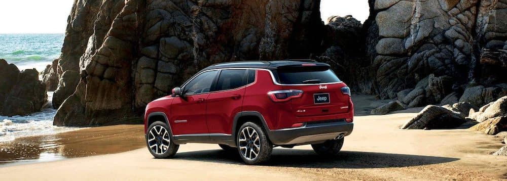 Red 2019 Jeep Compass Parked at the Beach