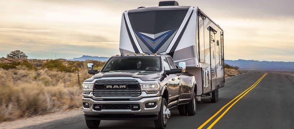 2019 Brown Ram 3500 Towing A Trailer