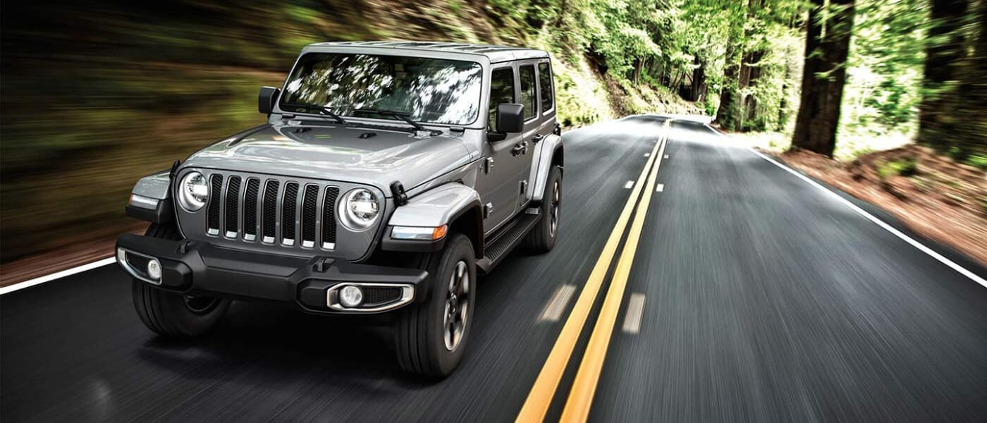2019 Silver Jeep Wrangler Driving on The Highway