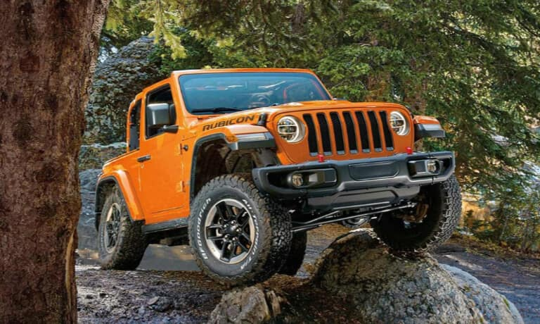 2019 Orange 2-Door Jeep Wrangler Parked on a Rock
