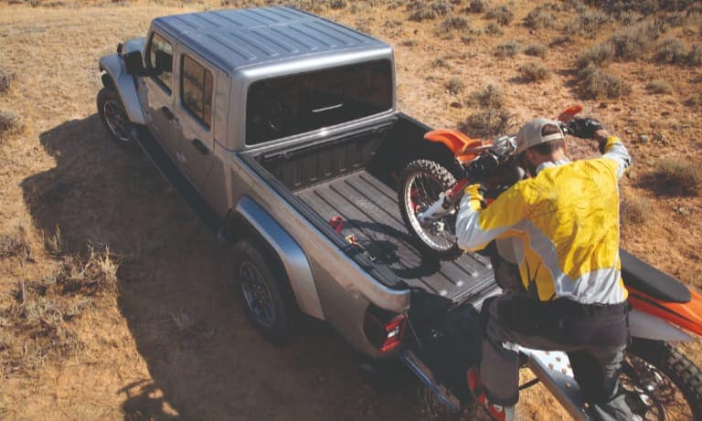 2020 Red Jeep Gladiator Towing Two Dirt-bikes