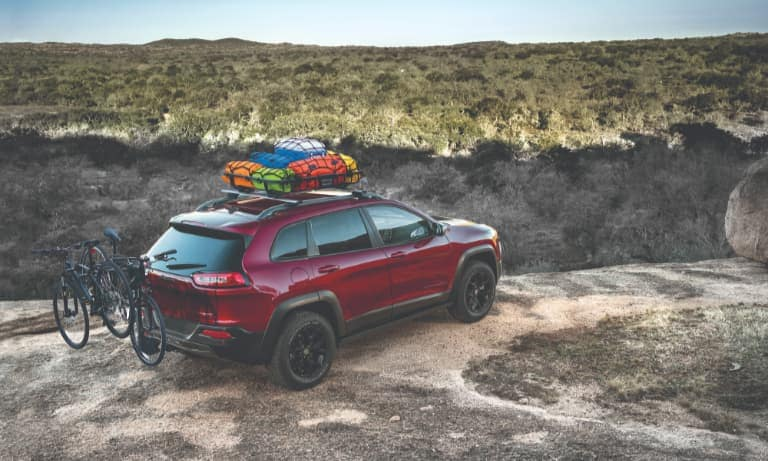 Jeep Cherokee Hauling Camping Gear and Bikes