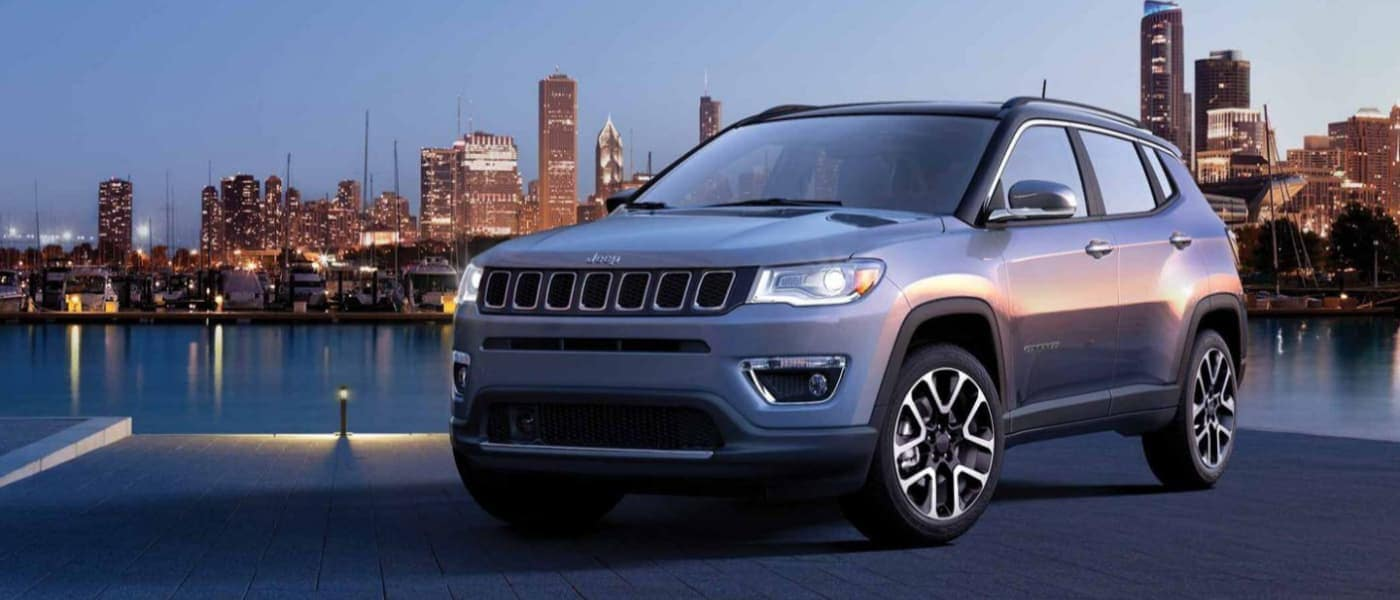 2020 Jeep Compass Parked at Night in Front of a City