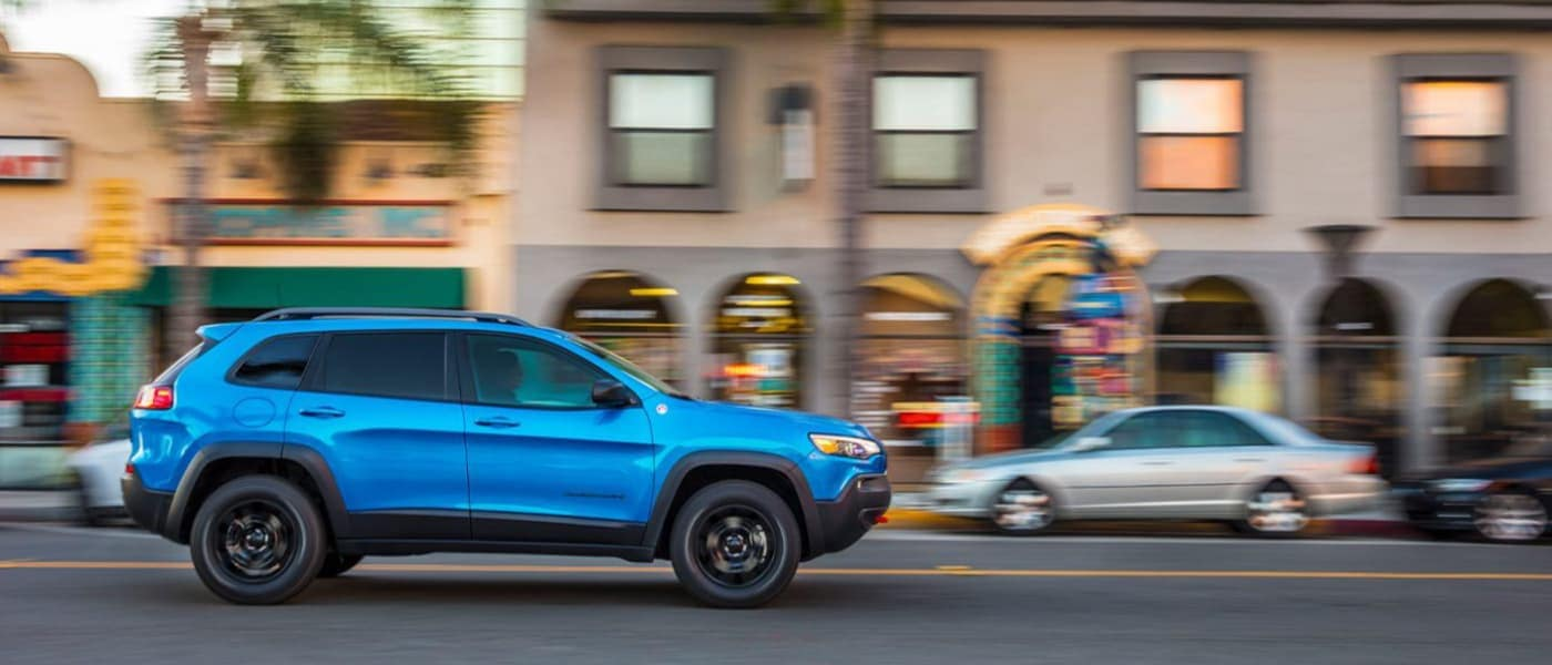 2020 Blue Jeep Cherokee Driving Downtown