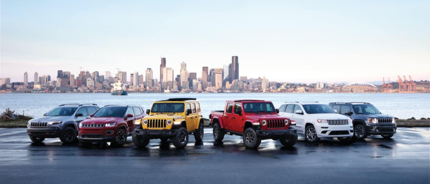Jeep Vehicles Lined Up on the Water Outside the City