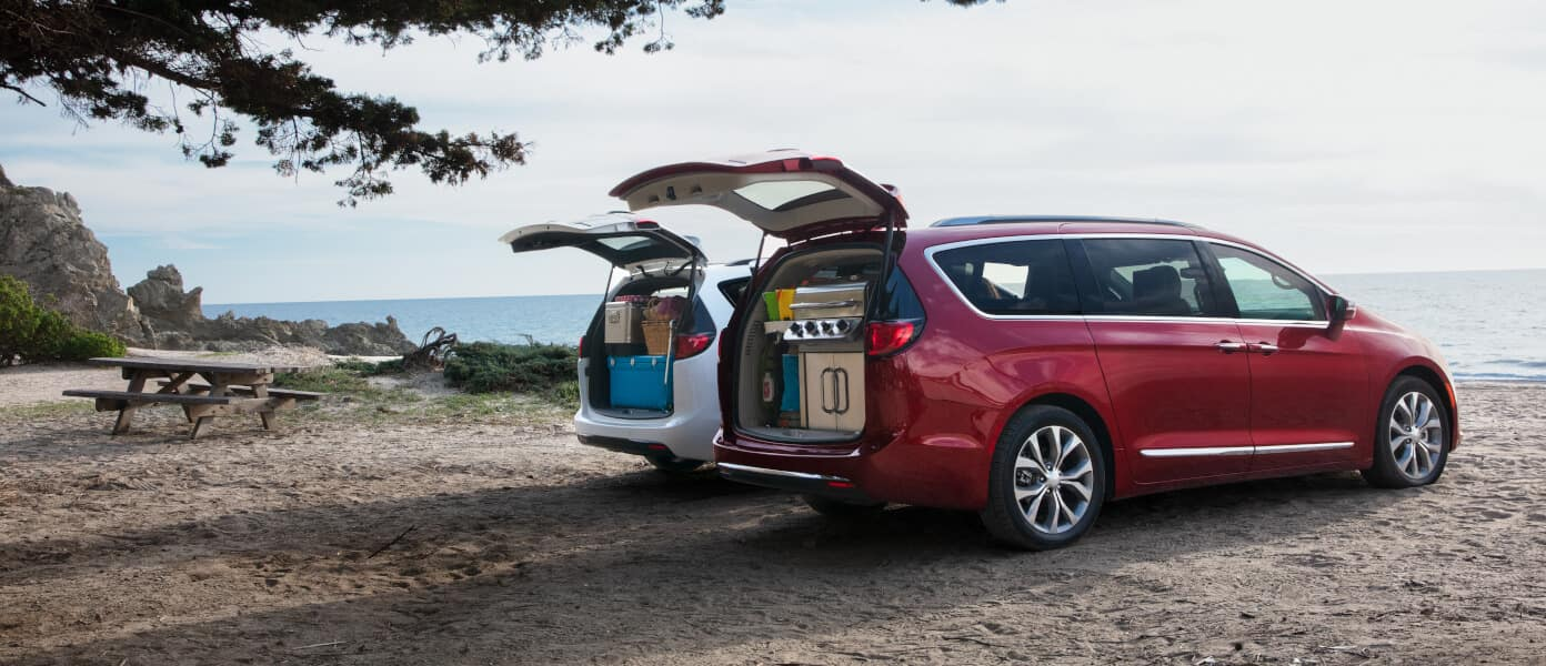 Red and White 2020 Chrysler Pacifica Parked with Their Trunks Open