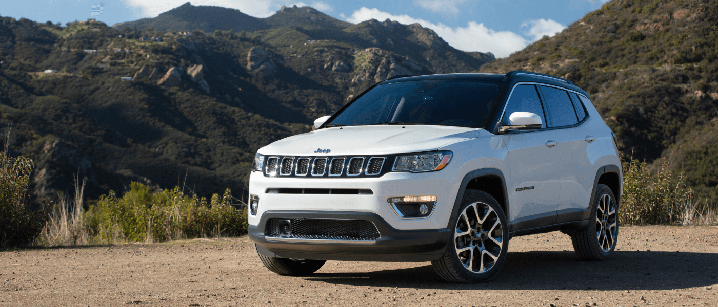 2021 White Jeep Compass Parked in the Mountains