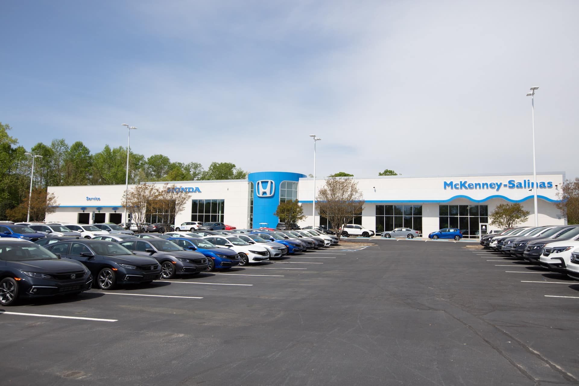 Outside image of dealership and lot