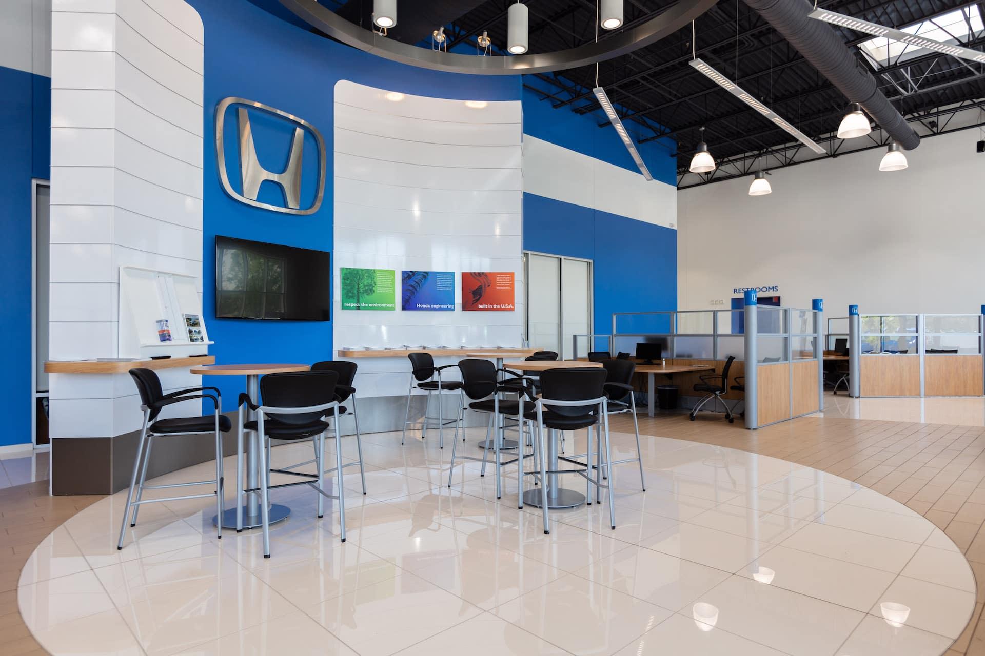 customer sitting area inside showroom at Mckenney-Salinas Honda
