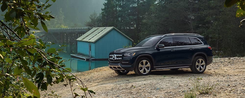 Mercedes-Benz GLS Parked in Wood by Lake House