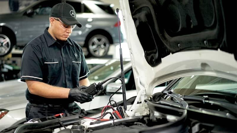 Mercedes-Benz Service Technician Fixing Car