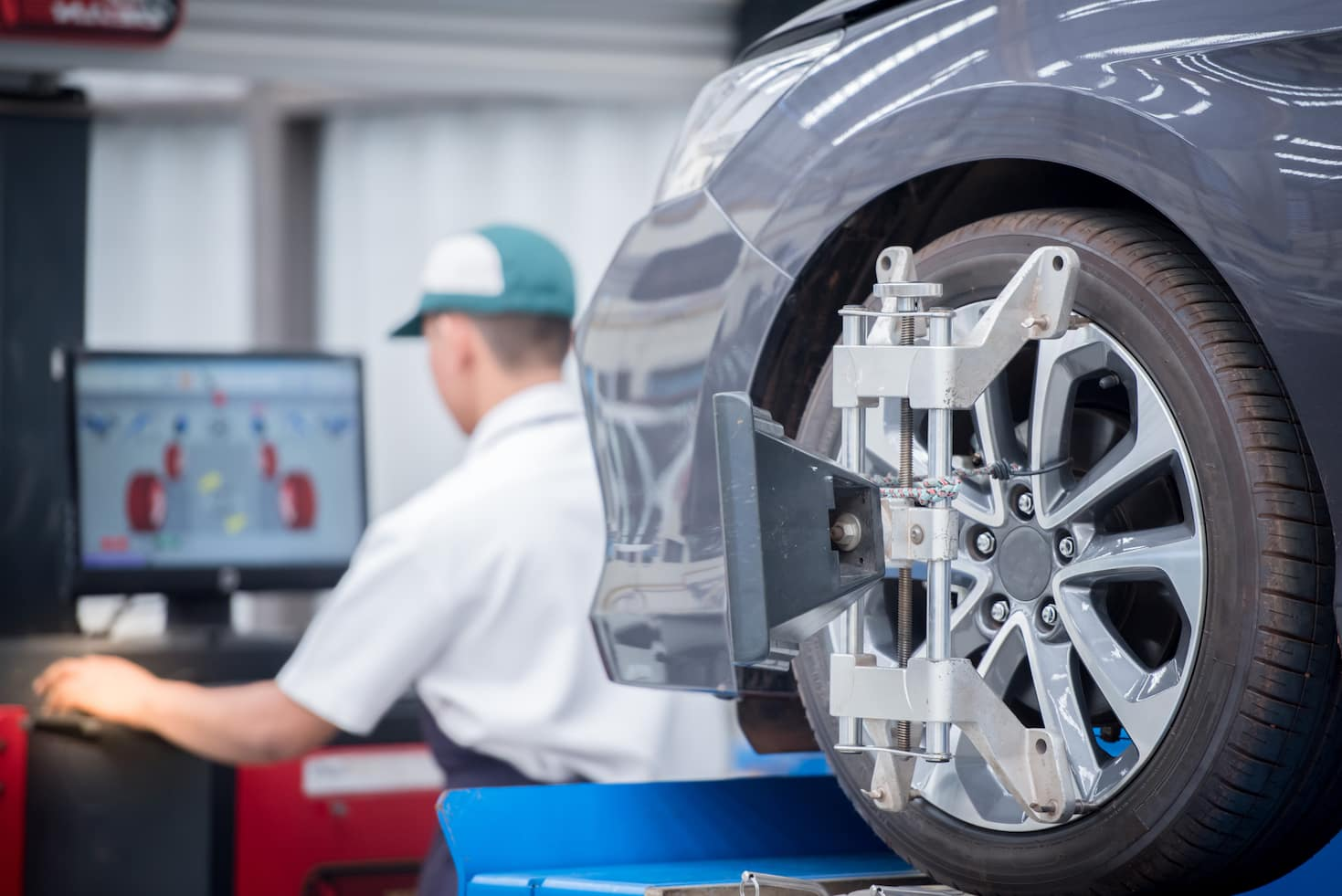 Mercedes-Benz technician performing tire alignment service