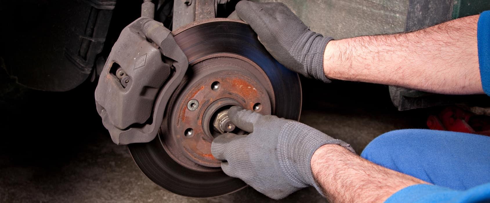 man repairing brakes