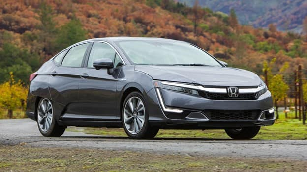 gray 2021 Honda Clarity plug-in hybrid mid-size sedan with LED lights and a chrome grille