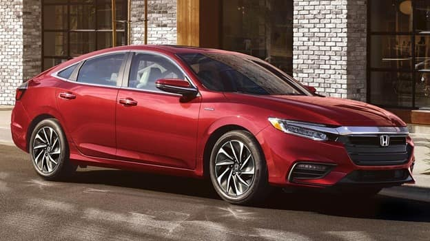 red 2021 Honda Insight with a black grille and chrome accent on the mirror cap and grille