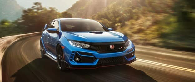 light blue-colored 2021 Honda Civic Type R with a black grille, red grille badge, and LED lights