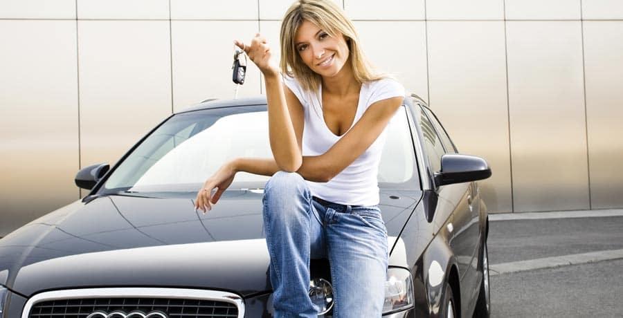 A woman holding car keys