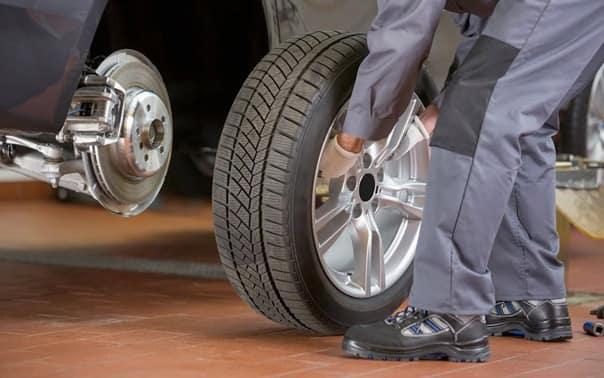 Mechanic Putting Tire on