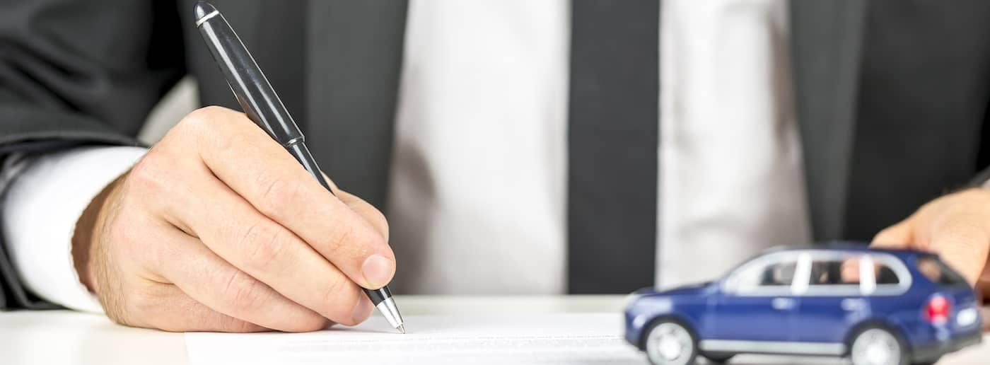 Signing auto loan paper