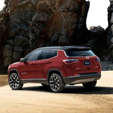 Red 2019 Jeep Compass on beach