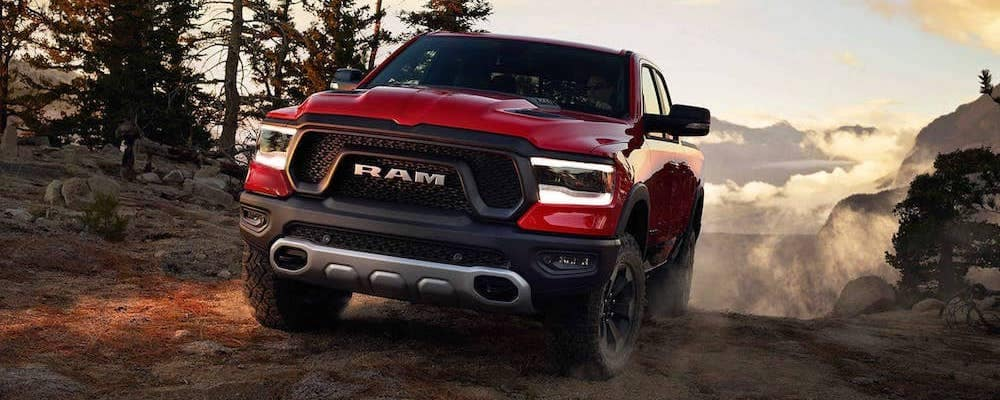 2019 ram 1500 rebel in red in the mountains