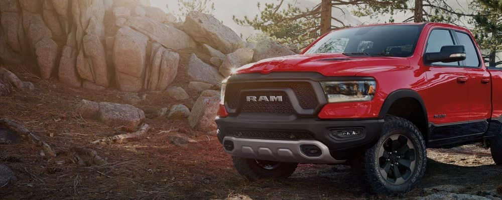Red Ram 1500 parked in a wooded area