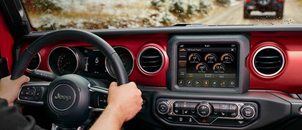 Red and black Jeep Wrangler dashboard