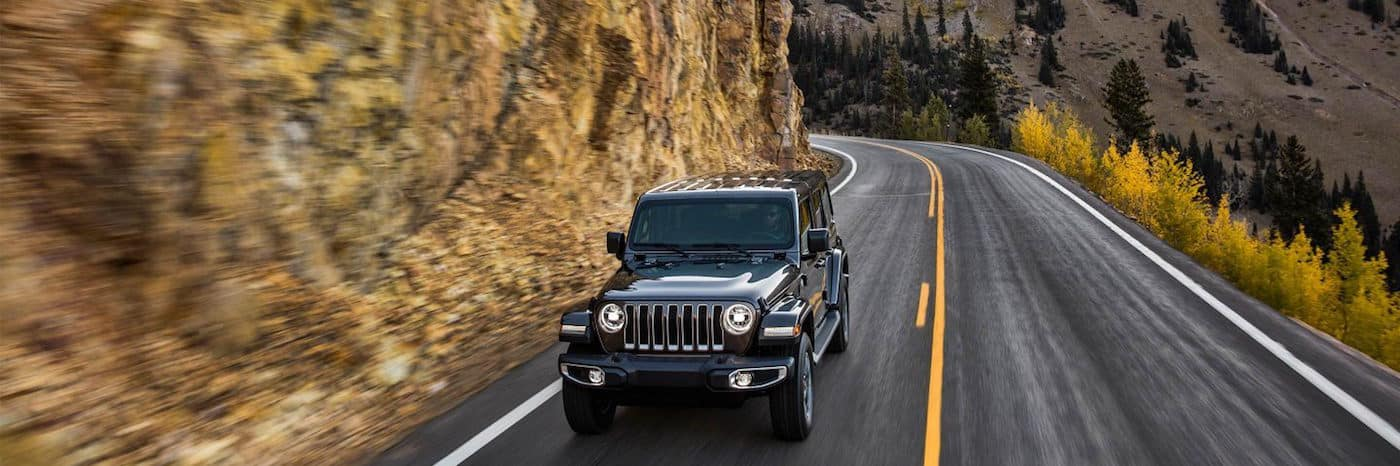 Jeep Wrangler driving on the side a mountain
