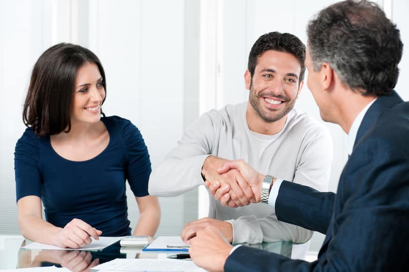 Couple meeting with a finance advisor