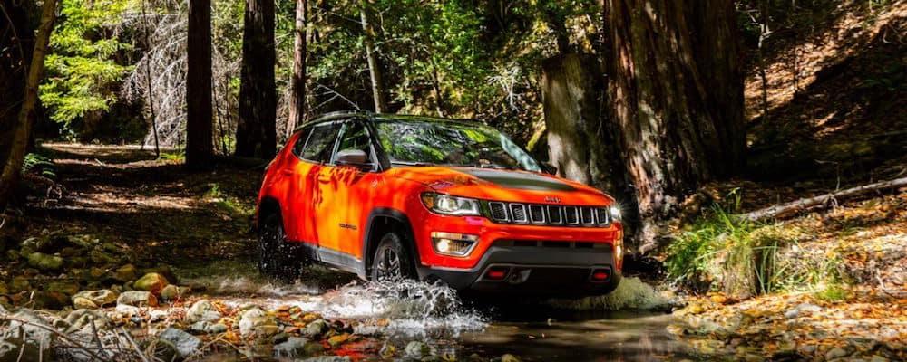 Orange Jeep Compass off-roading