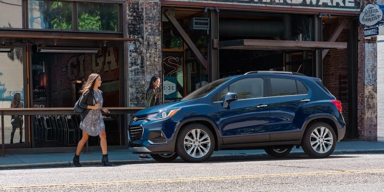 women walk to 2019 Chevrolet Trax