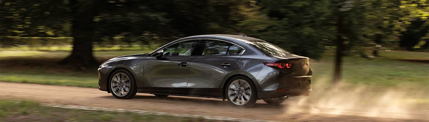 Mazda3 Sedan Driving on Dirt Road